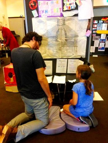 Museum staff member chats with student about her exhibit. Photo: Cam Hocking Source: Museum Victoria.